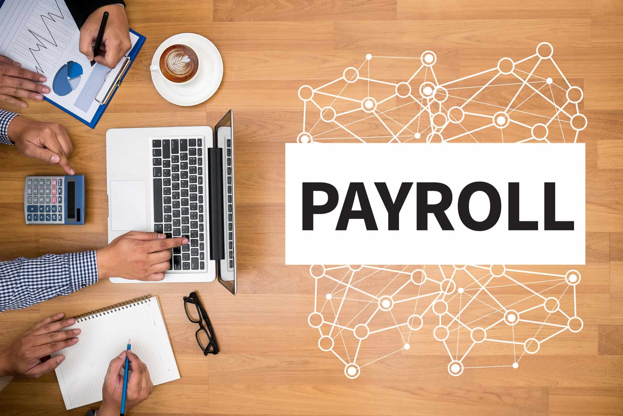 PAYROLL Business team hands at work with financial reports and a laptop